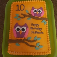 Owl Birthday Cake Two quarter sheets. Covered in orange buttercream as per my daughter's request. Decorations made of fondant.