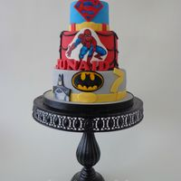 Super Hero Super hero cake for a 7 year old boy. the logo's and pictures of the super heroes are handpainted, i just love doing that