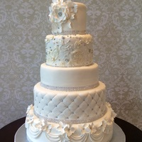 White Wedding Cake   Fondant covered with gumpaste accents with bling.
