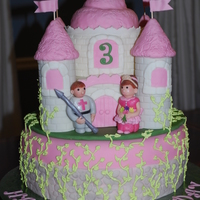 Castle Cake Fondant decorations with royal icing vines.