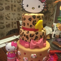 Hello Kitty Birthday Cake 3 Tier Cake, Vanilla, bottom, Choch and Lemon. Each layer has 3 layers, Fondant covered.