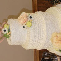 Rustic Lace And Ruffle Wedding Cake Alternating tiers of buttercream ruffles and lace. Sugar flowers