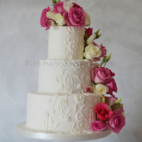 Wedding Cake Three tier wedding cake with lacework and fresh flowers