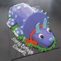 Purple Triceratops A purple/blue Triceratops birthday cake for a 6 year old girl. Covered in fondant. Everything is edible except for the boney plate. I didn...