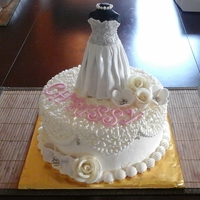 Bridal Shower Topper made of fondant, vanilla cake with cream icing,