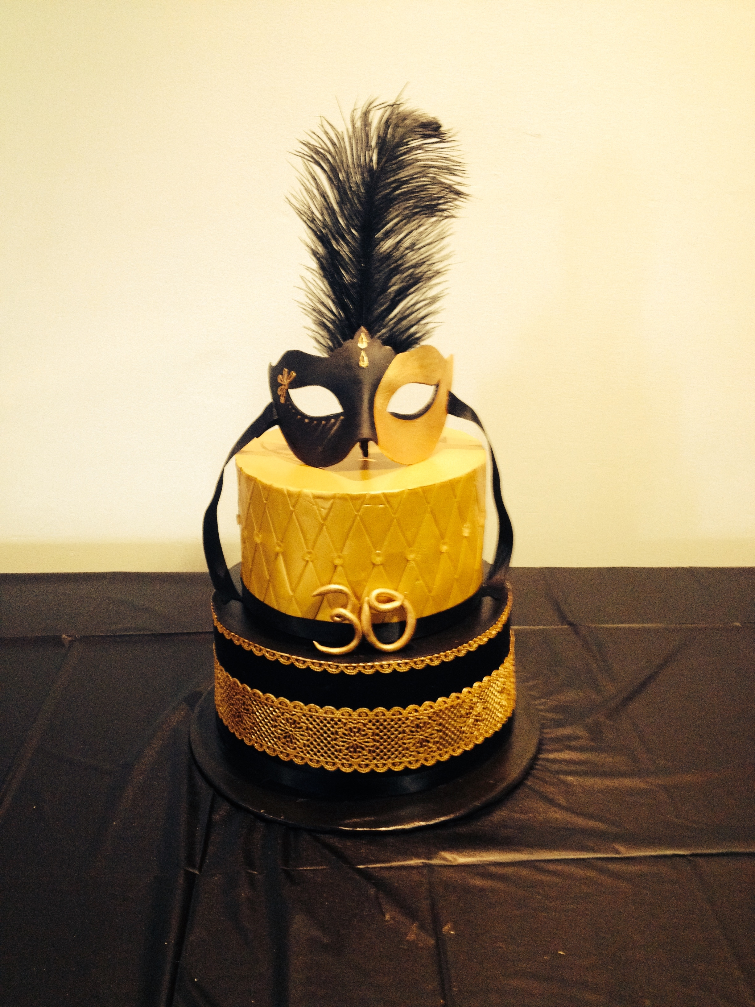 Black And Gold 30Th Masquarade Birthday Cake Made for a black and gold masquerade birthday cake.