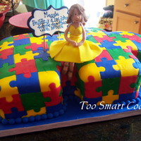 Autisim Puzzle Cake Carved cake covered in fondant puzzle and topper