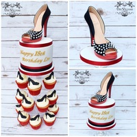 Louboutin Cupcake Tower A sugar, studded Louboutin stiletto atop a small cake and cupcakes