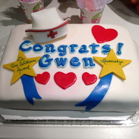 Celebrating A Nurse Award Quarter sheet cake covered in fondant with fondant decorations for a work celebration.