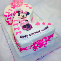 "Minnie Mouse Number 2 Cake Hand Carved Minnie Mouse number two cake. Made from 10"" and 1/4 sheet cakes, stacked three layers high."