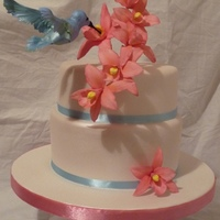 Hummingbird And Orchids Sugarpaste decorations on fondant covered fruit cake