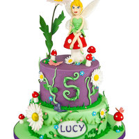 Tinkerbell A 2 tier vanilla and chocolate cake with modelled tinkerbell topper.....Hope you like it!