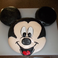 Mickey Mouse Six inch round cakes for ears, trimmed a 9-inch cake for the face. Covered in fondant.