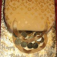 Louis Vuitton Purse Birthday Cake My daughter was born on the 1st of the month so I came up with this idea for her first birthday cake - for her Golden Birthday. Louis...