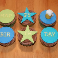 Men's Birthday Cupcakes Chocolate cupcakes with chocolate buttercream, fondant decorations.