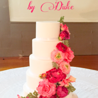 Wedding Cake This cake is very simple but yet very elegant the different color of pink flowers just make it look perfect.