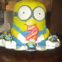 "Minion 3D This cake was made with 2 8X3"" rounds and an 8X5""? domed metal bowl. It took 2 hours for each of the rounds to cook @ 325* and..."