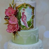 Vintage Lady Vintage wedding cake with ruffles, edible lace, sugar flowers and berries. The Victorian lady garden scene was hand painted.