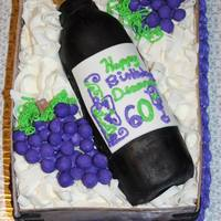 Wine Bottle Cake  2nd cake I made for my mom's birthday. The cake was covered in buttercream and marshmallow fondant. All designs on top were made with...