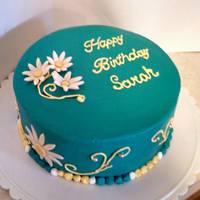 Teal Daisy Cake This was a last minute cake for my cousin. Teal is her favorite color. WASC BC frosting, fondant daisies.