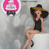 Fondant Girl With Hat I made this cake topper for an etsy customer based off a poster. She's almost 12 inches tall :)