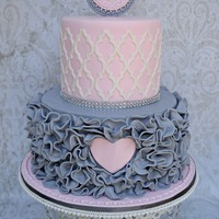 Pink Heart Pink and grey ruffles around a pink heart baby shower cake.
