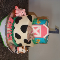 Barnyard Birthday Cake Vanilla butter cake for one layer and chocolate for the other. Crusting cream cheese frosting. Fondant decorations.