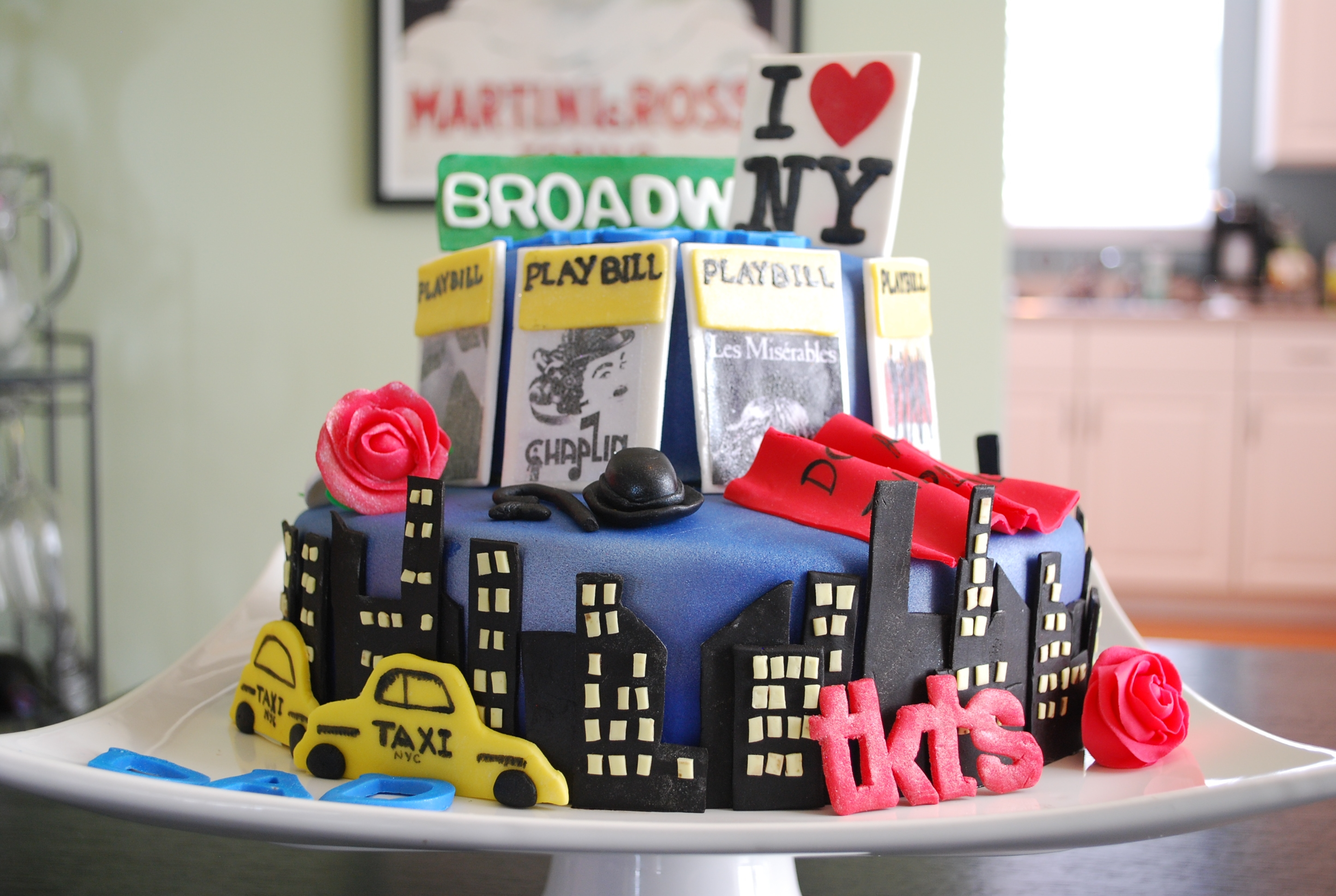 Broadway Cake  70th birthday cake for my dad who loves Broadway! Incorporated his favorite shows: Les Mis, Phantom of the Opera, Chaplin, and Jersey Boys...