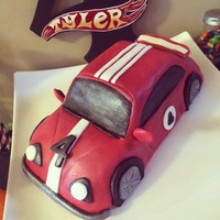 Race Car Cake  4th Birthday hotwheels theme party with race car cake, finish line cake, and cupcakes. The edible hotwheels cars were made with a car mold...