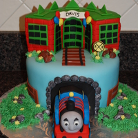 Thomas The Train Sorry to say that I don't know who initially designed this cake but it was so fun to recreate!
