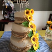 First Wedding Cake Used topsy turvy pans, gum paste sunflowers.