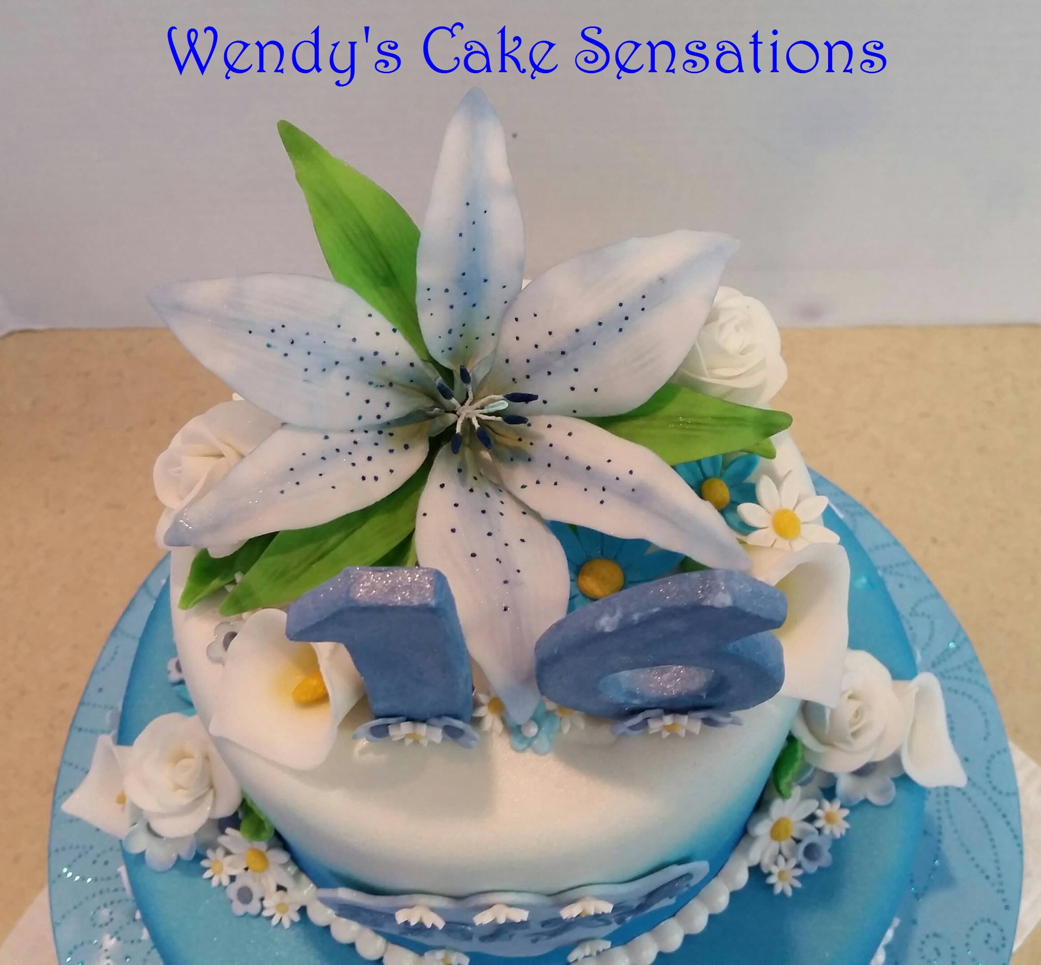 16Th Birthday Blue Lily Flower Cake CakeCentral