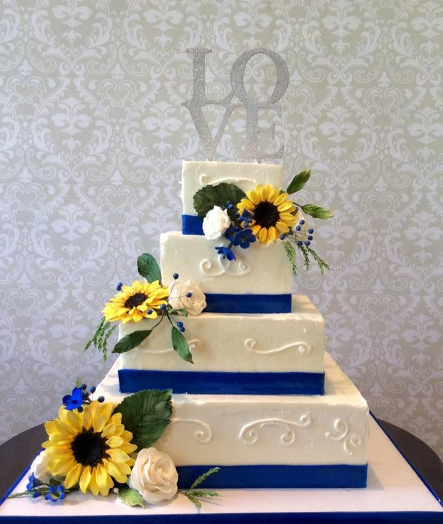 Wedding Cake Sunflowers Roses And Blue Accents