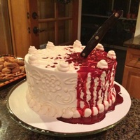 "Halloween Bloody Knife Cake Buttercream cake with piping and real knife; edible ""blood"" spill"