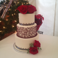 Winter Red And Gray Wedding This wedding cake was for the week after Christmas. I love how the scrollwork and red buttercream pearls look with the Christmas pines and...