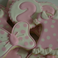 Minnie Mouse Cookies light pink & white cookies decorated for Minnie Mouse themed party - dresses, number 2 and bows with pink & white polka dots