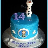 Frozen Cake   Frozen Olaf and Anna cake with fondant figure and edible image.