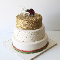 Golden Glamour Indian Themed Cake designed to match the brides dress colours.