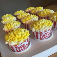"Popcorn Cupcakes Popcorn Cupcakes. Marshmallows with yellow food color spray for ""popcorn""."