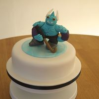 Skylanders Gusto, With A Hockey Stick!  This was done for my nephew who requested Gusto from Skylanders, holding a hockey stick! It's a rich chocolate cake filled with...
