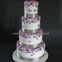 Shades Of Purple Daisy Wedding Cake Different shades of purple to match the bouquet colours - PJ x