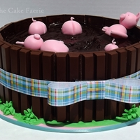 "Pigs In Mud I was asked to recreate the viral ""Pigs in Mud"" candy barrel cake and here is my work! It was a lot of fun to mold the fondant..."