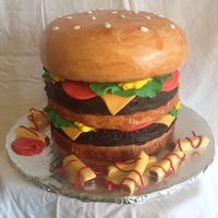 Hamburger Cake This is a 5 layer cake. The patties are chocolate and the bun is vanilla. Bun covered in MMF and painted with watered down brown and ivory...
