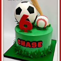 Sports soccer ball and baseball themed cake for a boy who loves both sports