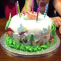 Fairyland Cake Made this for my daughter's birthday. It was hard work working with silicon moulds because I was using plain fondant and had no idea...