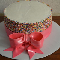 Sprinke Cake multi colored sprinkles with large pink gumpaste bow