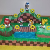 Sonic And Friends BC and fondant with store bought plastic figures. The ramp is RKT covered in fondant.