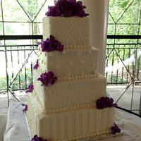 "Square Wedding Cake All buttercream wedding cake. Sizes are 6,8,10 and 12"". Fresh flowers"