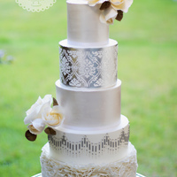 Classic Modern Silver/pearl Wedding Cake This Classic Modern Cake design was inspired by Faye Cahill Cakes Designs. A variety of different techniques were used on this cake from...