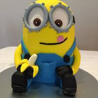 Minion Cake Layers of Nutella and Banana cake filled with Nutella and choc buttercream.